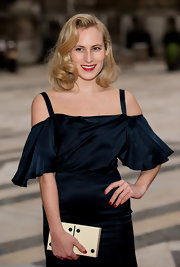 Charlotte Dellal kept up her retro glam look with a couple coats of red nail polish.