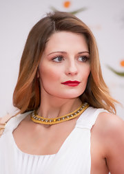 Mischa Barton attended the Women for Women Institute Gala in London wearing her hair long and straight with a sexy side part.