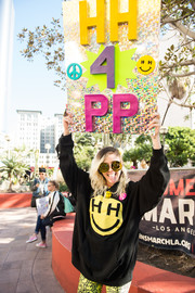 Miley Cyrus joined the women's march in Los Angeles wearing an oversized Happy Hippie Foundation hoodie.