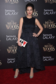 America Olivo donned a regal-looking black high-low gown for the 'Into the Woods' premiere.