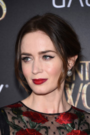 Emily Blunt pulled her hair up into a messy-romantic center-parted updo for the premiere of 'Into the Woods.'