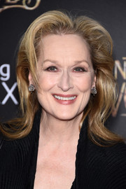 Meryl Streep styled her hair with teased bangs and flippy ends for the premiere of 'Into the Woods.'