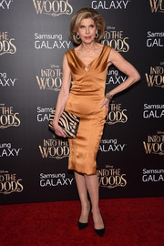 Christine Baranski complemented her lovely dress with a black and gold zebra-print clutch.