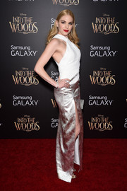 Mackenzie Mauzy looked alluring at the 'Into the Woods' premiere in a white and gold halter dress with an up-to-the-hip slit.