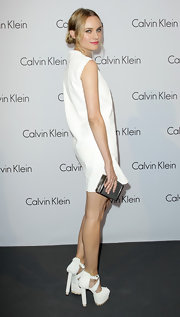 Diane Kruger paired her sky high heels with a silver box clutch.