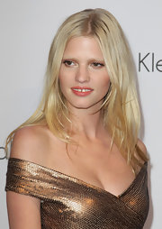 Lara Stone posed for cameras as she showed off her center part blonde locks.