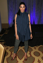 Rachel Roy attended the World of Children Award Alumni Honors wearing a loose blue ruffle blouse.