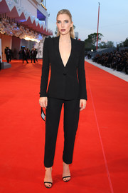 Vanessa Kirby opted for a plunging black pantsuit by Armani Prive when she attended the Venice Film Festival screening of 'The World to Come.'