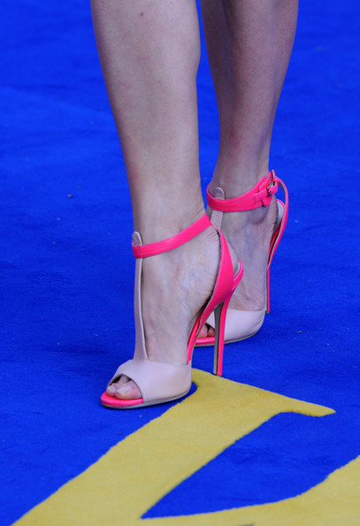 Rosamund Pike's hot pink and nude strappy sandals complemented her hot pink bra.