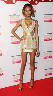 Jourdan Dunn's figure was perfection in this body-con gold and white mini dress by Balmain at the World's First Fabulous Fund Fair.