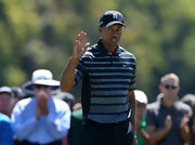 Tiger stuck to a gray and black striped polo for his preppy on-the-course look.