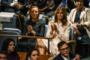 Melania Trump was spotted at the United Nations General Assembly wearing a cream-colored shirtdress by Gucci.
