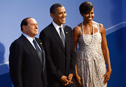 Michelle supports her world leaders in a single strand necklace over her Thakoon gown.
