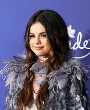 Selena Gomez looked charming with her loose pigtail braids at the world premiere of 'Frozen 2.'
