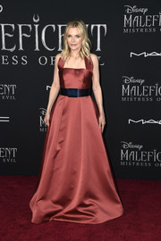 Michelle Pfeiffer oozed elegance wearing this maroon halter gown by Armani at the world premiere of 'Maleficent: Mistress of Evil.'