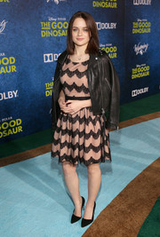 Joey King contrasted her ladylike dress with an edgy black leather jacket.