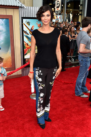 Catherine Bell spruced up her plain top with a pair of scarf-print pants.