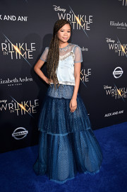Storm Reid went for a boho finish with a tiered blue maxi skirt, also by Coach.