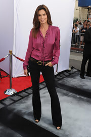 Cindy Crawford rocked the 'Iris' premiere in a raspberry pink blouse complete with ruffled detail. She paired the top with black pants and gold accessories.