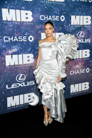 Tessa Thompson radiated in a silver one-shoulder dress with a statement sleeve and an asymmetrical ruffle hem at the world premiere of 'Men in Black: International.'