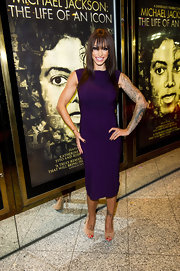 Jodie Marsh looked glamorous in this sleek purple dress at the Michael Jackson premiere.