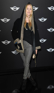 Mary Charteris looked exotic in a hooded black cardigan with gold trim during the new Mini world premiere.