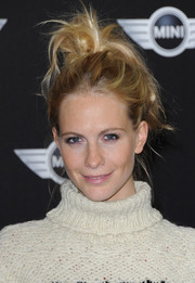 Poppy Delevingne went punk with this messy updo at the new Mini world premiere.