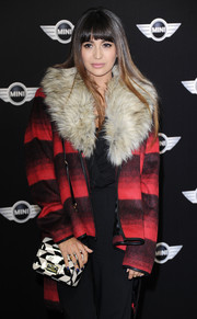 Zara Martin complemented her coat with a black-and-white shoulder bag when she attended the new Mini world premiere.