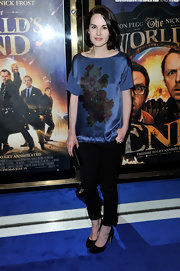Michelle Dockery rocked florals in a unique way with this loose-fit, blue satin shirt with floral designs.