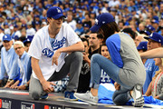 Mila Kunis teamed gray Under Armour running shoes with jeans and a raglan tee for game six of the 2017 World Series.