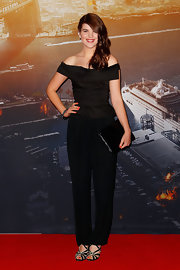 Emma Birdsall paired black slacks with an off-the-shoulder top for a classy finish at the 'World War Z' Australian premiere.