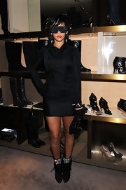 "Rihanna often accessorizes her fierce outfits with one-of-a-kind sunglasses. Here, she wears the ""Barracuda"" glasses with her Alexander Wang dress."