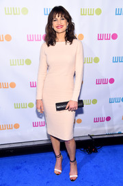 Carla Gugino wore a long-sleeved blush midi dress that showed off her figure.