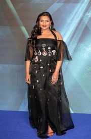 Red satin sandals polished off Mindy Kaling's look.