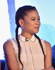 Storm Reid accessorized with a pair of elegant pearl hoops.