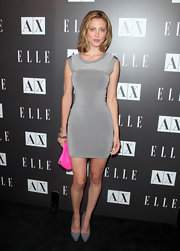 Eva Amurri paired her silver bandage dress with a hot pink clutch and grey patent leather pumps.