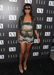 Keri Hilson paired her abstract print romper with a silk bomber jacket.