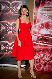 Dannii is smashing in red at the 'X Factor' premiere.