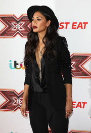 Nicole Scherzinger layered an embellished black Barbara Bui blazer over a plunging wrap top for the 'X Factor' series 14 launch.