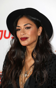 Nicole Scherzinger topped off her look with a black porkpie hat.