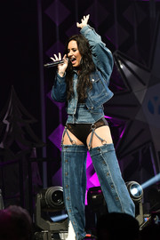 Demi Lovato performed at Y100's Jingle Ball 2017 wearing an Urban Outfitters denim jacket and some bizarre-looking jeans.