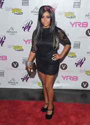 Snooki opted for a black lace cocktail dress at the YRB Magazine party. She donned a Flintstone bow in her hair and carried an LV bag.