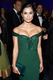 Diane Guerrero accessorized with a pearlized green clutch to complement her emerald gown at the Yahoo News White House Correspondents' Dinner pre-party.