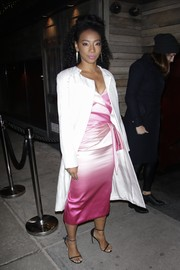 Betty Gabriel was seen out in New York City wearing a white silk coat over a pink dress.
