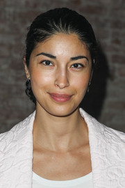 Caroline Issa styled her hair into a simple chignon for the Yigal Azrouel Spring 2014 show.