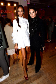 Joan Smalls looked cool in a white shirtdress with feathered sleeves at the YouTube.com/Fashion launch.