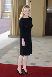 Duffy looked sophisticated in a long-sleeved black sweater dress at the Young People and the Performing Arts reception.