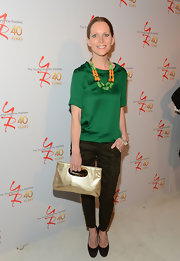 Lauralee Bell topped off her look with forest green skinny pants.
