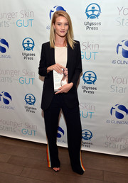 Rosie Huntington-Whiteley teamed side-striped track pants by Chloe with a Saint Laurent blazer for the 'Younger Skin Starts in the Gut' book launch.
