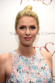 Nicky Hilton attended the 'Yves Saint Laurent' premiere wearing a cute top knot.